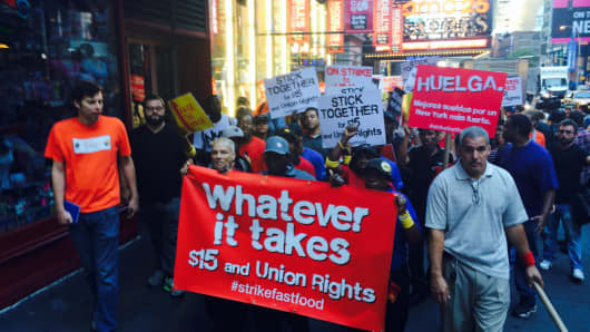 Fast food workers protesting outside a McDonald's in Times Square, New York